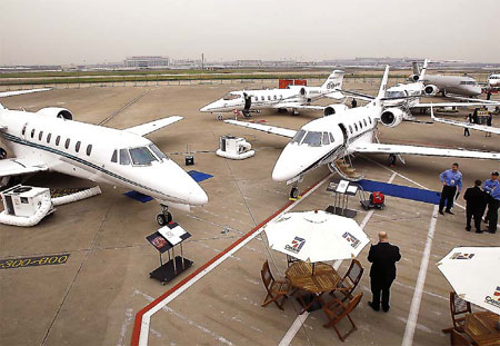 Business jets at Hongqiao airport in Shanghai. The Canada-based plane producer Bombardier Inc predicted that China will receive about 2,360 corporate jets by 2030.[China Daily]