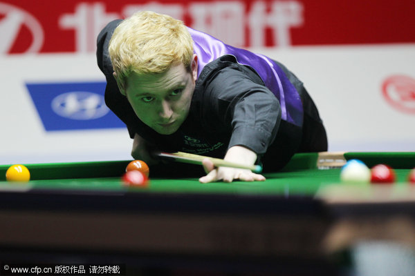Ding rallies to beat Woollaston in China Open