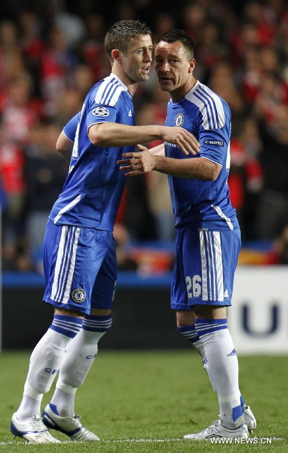 John Terry (R) of Chelsea talks to his teammate Gary Cahill who replaced him during the UEFA Champions League Quarterfinal second leg match between Chelsea and Benfica at Stamford Bridge on April 4, 2012 in London. (Xinhua/Wang Lili)