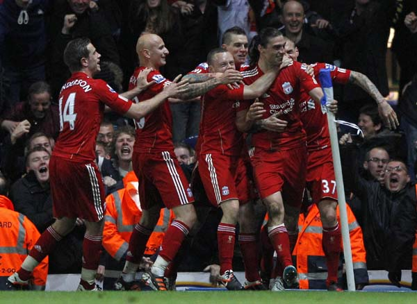 Carroll header lifts 10-man Liverpool