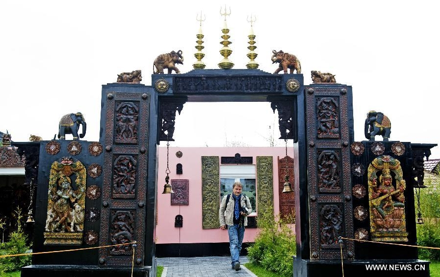 A visitor visits the Indian Garden at the Floriade 2012 in Venlo, the Netherlands, April 12, 2012. The Floriade 2012 exposition, a once-a-decade gardening extravaganza, opened to the public on Thursday featuring displays from 35 different countries. (Xinhua/Robin Utrecht) 