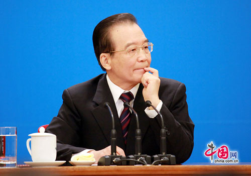 Chinese Premier Wen Jiabao meets the press after the closing meeting of the Fifth Session of the 11th National People's Congress (NPC) at the Great Hall of the People in Beijing, March 14, 2012.