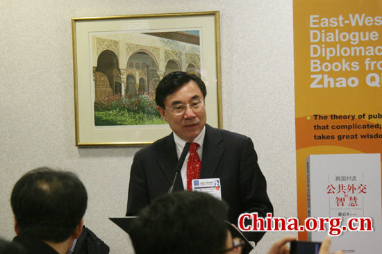Huang Youyi, vice president of China International Publishing Group (CIPG), hosts Zhao Qizheng's books launch ceremony at Piccadilly Room of Earls Court Exhibition Hall on April 17, 2012.