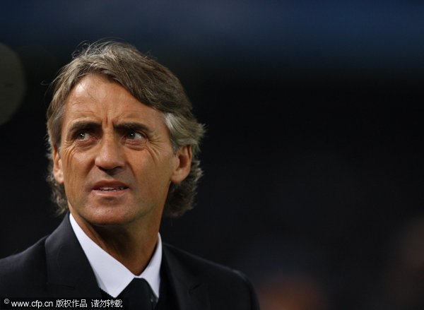 Roberto Mancini the coach of Manchester City looks on during the UEFA Champions League Group A match between SSC Napoli and Manchester City FC at Stadio San Paolo on November 22, 2011 in Naples, Italy.
