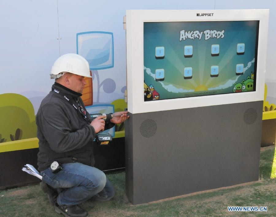 A worker installs a large touch screen of the 'Angry Birds' game at the Angry Birds Land built in Sarkanniemi Adventure Park, Tampere, Finland, April 25, 2012.