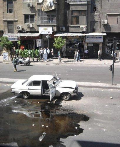 A damaged car is seen after an explosion at al-Sinaa district, a residential neighbourhood south of Damascus April 27, 2012. An explosion was heard on Friday in the Syrian capital Damascus near a government facility housing militiamen loyal to President Bashar al-Assad, residents and activists said.