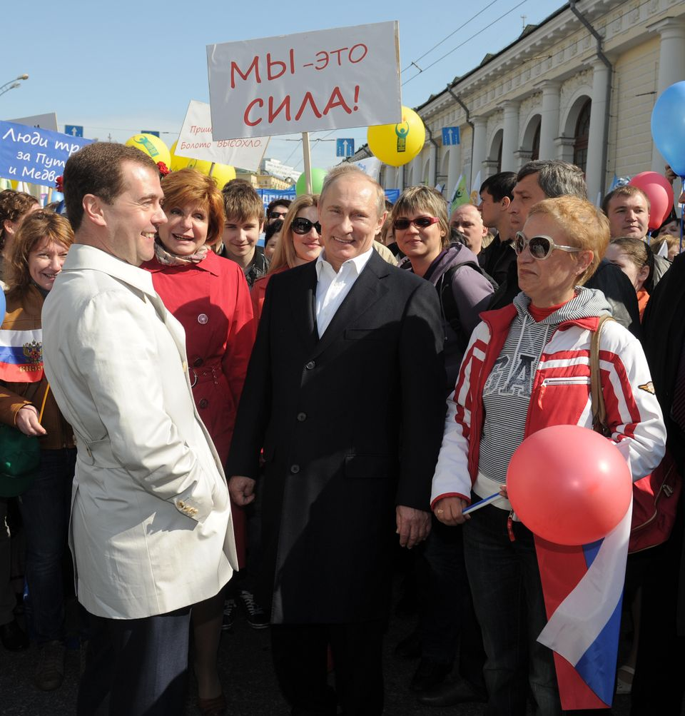Russian President Dmitry Medvedev and President-elect Vladimir Putin attended a 150,000-people march in Moscow on Tuesday to mark the International Workers' Day, or May Day.