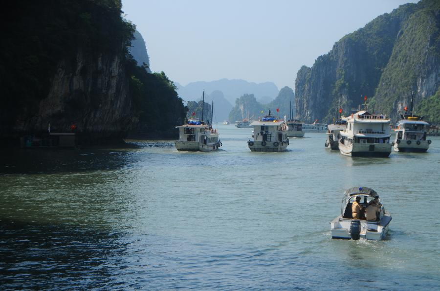Ships cruise at Vinh Ha Long, a beautiful scenic spot of Vietnam, on May 1, 2012. Ha Long Vinh attracted 24,000 tourists home and abroad on April 29, according to local statistics. (Xinhua/Li Dan) 