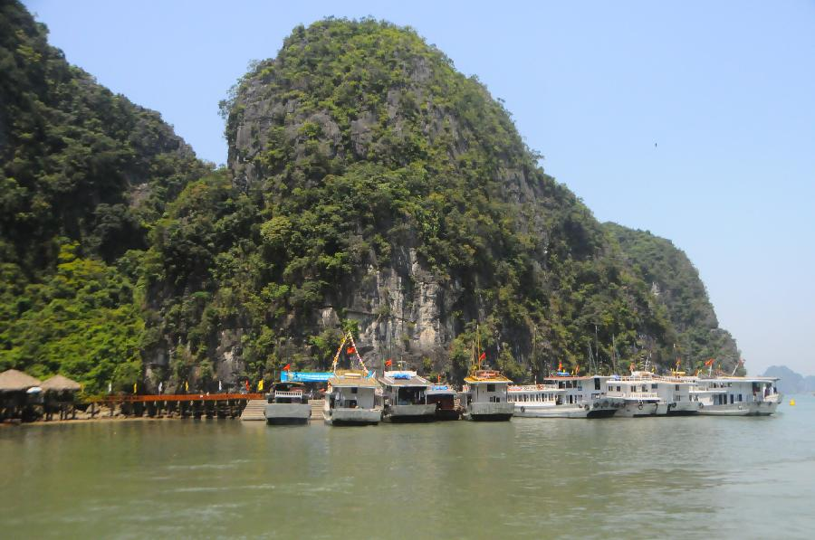 Ships anchor at Vinh Ha Long, a beautiful scenic spot of Vietnam, on May 1, 2012. Ha Long Vinh attracted 24,000 tourists home and abroad on April 29, according to local statistics. (Xinhua/Li Dan)