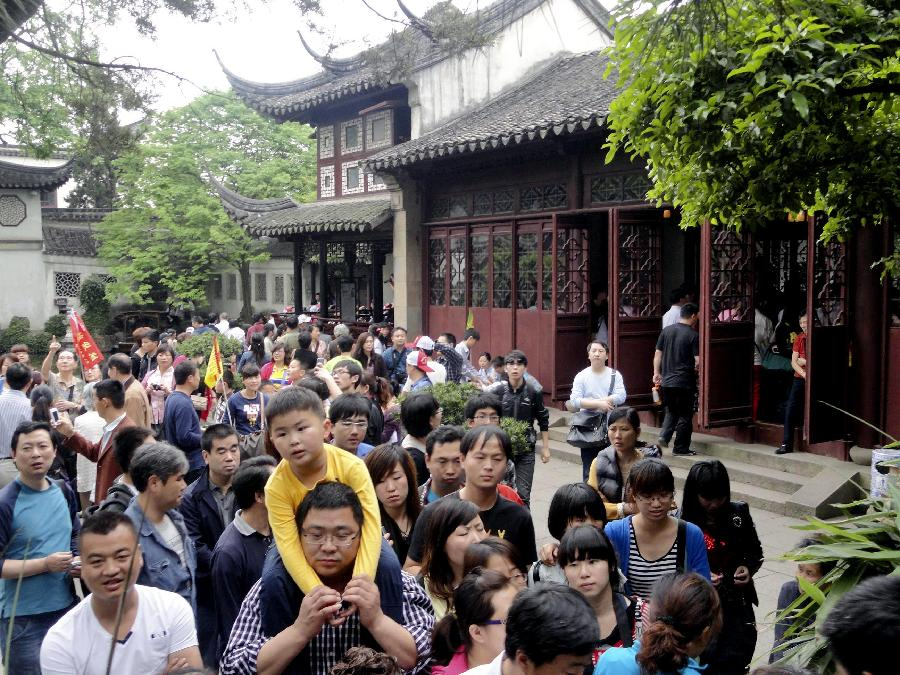 The Lingering Garden, one of the four most well-known gardens in China, is swarmed with tourists in Suzhou, east China's Jiangsu Province, April 30, 2012. As weather warms, a good many people choose to spend the three-day Labor Day holiday in travelling. (Xinhua/Wang Jiankang)