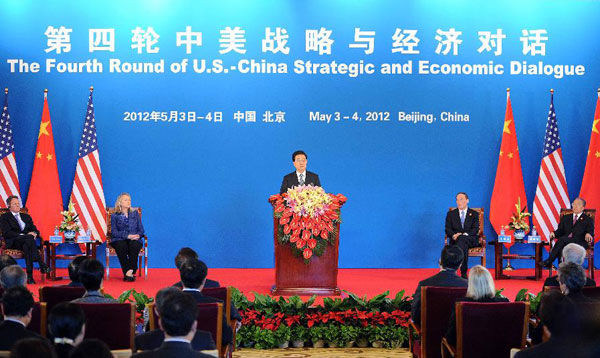 Chinese President Hu Jintao (C) addresses the opening session of the fourth round of the China-U.S. Strategic and Economic Dialogue in Beijing, capital of China, May 3, 2012. [Xie Huanchi/Xinhua]
