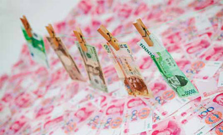 Yuan, yen, won and dollar banknotes. China, Japan, and South Korea have agreed to use their foreign exchange reserves to invest more in each other's treasury bonds, a step meant to maintain stability in their financial markets. [China Daily]