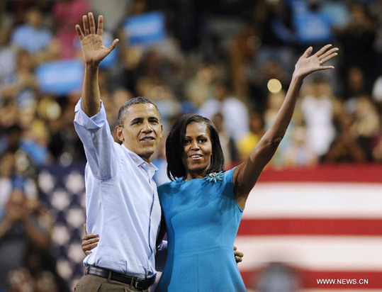 U.S. President Barack Obama (L) and First Lady Michelle Obama attend a campaign event at Virginia Commonwealth University in Richmond, Virginia, the United States, May 5, 2012. [Xinhua]