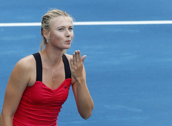 Azarenka, Sharapova advance in Madrid