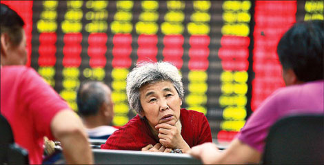 Investors at a brokerage in Huaibei, Anhui province, on Monday. China plans to set up a nationwide over-the-counter board, which will be open to some individuals. [China Daily]
