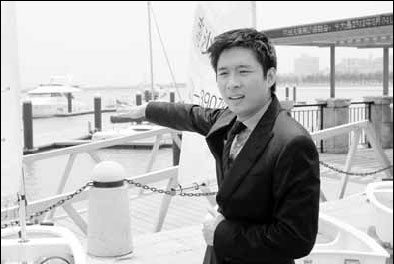 Eric Fok, president of Nansha Marina, a top Chinese yacht club, introduces the marina in Nansha district of Guangzhou on Friday. [China Daily]