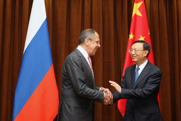 Foreign Minister Yang Jiechi meets his Russian counterpart Sergei Lavrov on Thursday. Lavrov is in Beijing to attend a meeting of foreign ministers of the Shanghai Cooperation Organization. [Jiang Dong/China Daily]