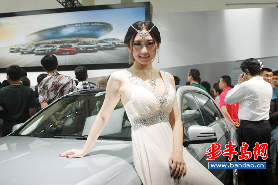 A Model Presents Car During The 11th Qingdao International Auto Show On May 16 Opened Its Doors At