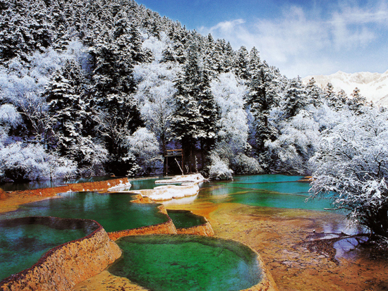 Huanglong, one of the 'top 10 attractions in Sichuan, China' by China.org.cn.