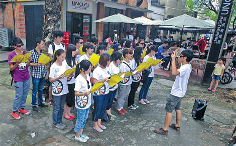 f8f3b4ccb54 The Guangzhou complaint choir performs in the street of the capital of  Guangdong province.