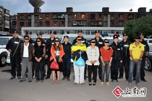 This undated photo shows child-trafficking suspects arrested in southwest China's Yunnan Province. [Source: Yunnan.cn]
