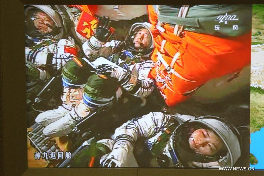 Photo taken on June 16, 2012 shows the screen at the Beijing Aerospace Flight Control Center showing China's astronauts Jing Haipeng, Liu Wang and Liu Yang after the launch of China's manned Shenzhou-9 spacecraft inside the return capsule. Shenzhou-9, atop an upgraded Long March-2F carrier rocket, blast off from the Jiuquan Satellite Launch Center in northwestern China at 6:37 p.m. Saturday and accurately entered its orbit. (Xinhua/Zha Chunming)