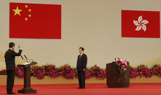 Chief Executive of the Hong Kong Special Administrative Region (HKSAR) Leung Chun-ying (L) takes his oath, administered by Chinese President Hu Jintao (R) at the Hong Kong Convention and Exhibition Center in Hong Kong, south China, July 1, 2012. [Lui Siu Wai/Xinhua]