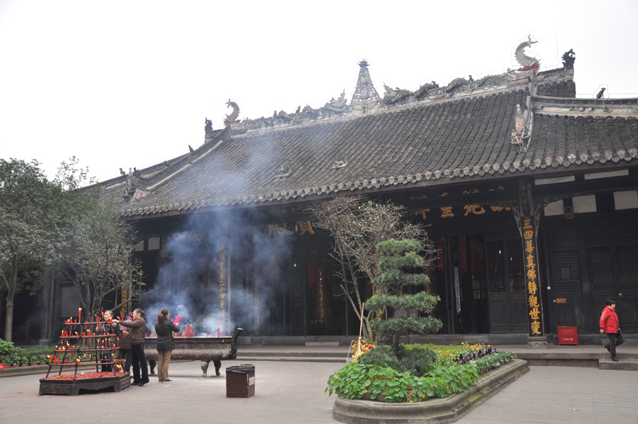 The Baoguang Temple is located in Xindu district 18 km north of Chengdu, China's Sichuan province. It was founded during the Tang Dynasty. The temples has a number of halls, including the Qing-era Arhat Hall, containing 500 two meter high clay figurines of Arhats. [China.org.cn /by Chen Xiangzhao]