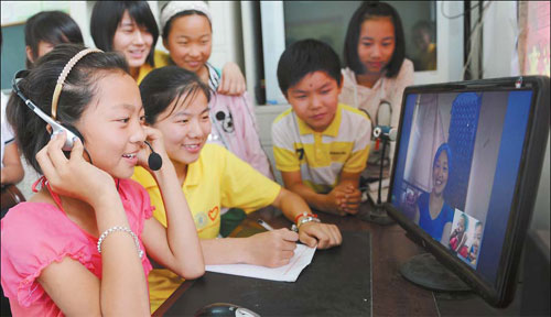 A student chats online with her mother in Jieshou, Anhui province. The number of Chinese Internet users increased 11 percent from a year earlier to 538 million at the end of June, or almost 40 percent of the nation's total population. Wang Biao / For China Daily