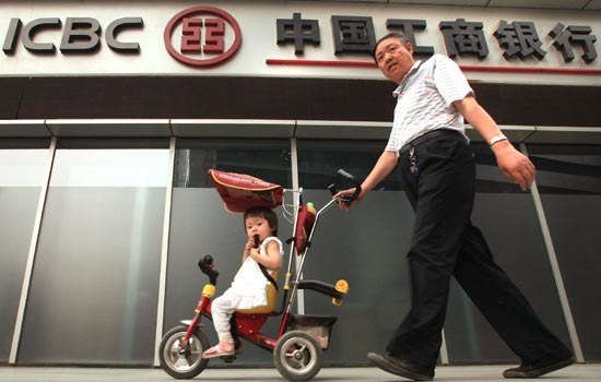 A branch of the Industrial and Commercial Bank of China Ltd in Beijing. China's corporate debt-to-GDP ratio stood at 107 percent in 2011, the highest among all countries, raising concern about their financial stability. [Photo/China Daily]