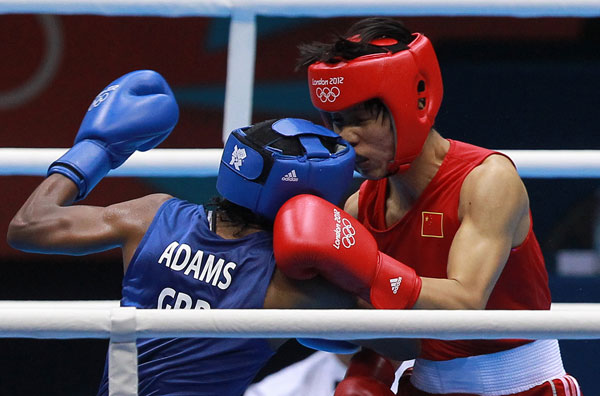 Ren Cancan of China (right) fights Nicola Adams of Great Britain during the women's boxing flyweight final at the 2012 London Games on Thursday. Adams won to claim the event's inaugural gold medal. [China Daily]