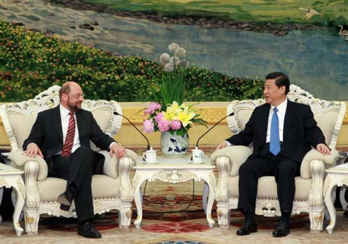 Chinese Vice President Xi Jinping (R) talks to Martin Schulz, chair of the Group of the Progressive Alliance of Socialists and Democrats in the European Parliament, in Beijing, capital of China, May 16, 2011. Xi met with leaders of European political parties attending the second China-Europe High-level Political Parties Forum. [Xinhua Photo]