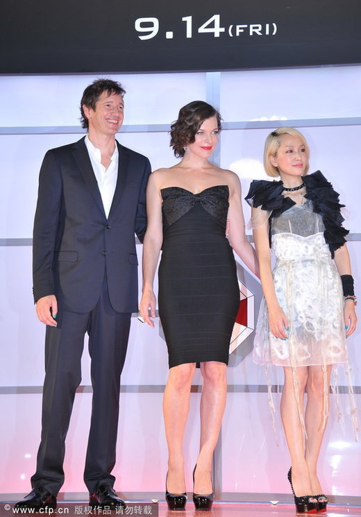(L-R) Director Paul W. S. Anderson, actresses Milla Jovovich and Mika Nakashima attend the 'Resident Evil: Retribution' World Premiere at Roppongi Hills on September 3, 2012 in Tokyo, Japan.