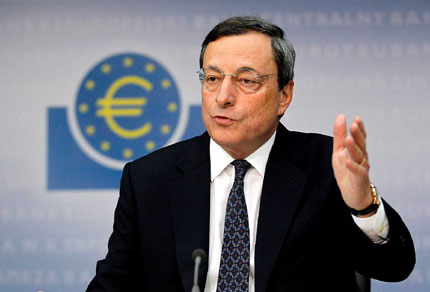 European Central Bank President Mario Draghi speaks during the monthly news conference in Frankfurt yesterday. Draghi unveiled a long-awaited program to buy up bonds and help bring down the borrowing costs of Europe's struggling governments.