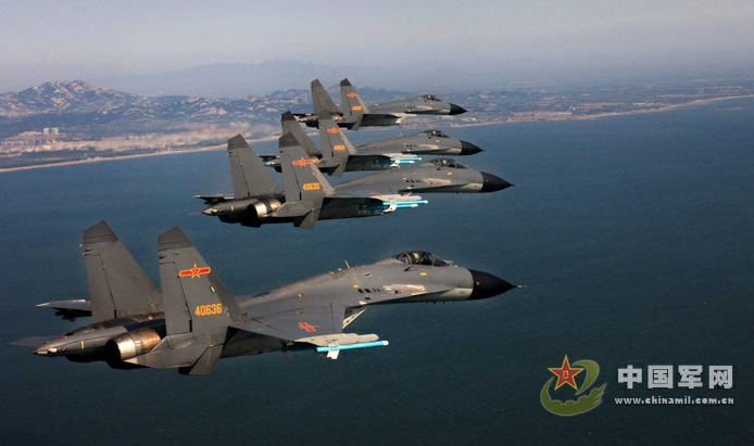 Crews at an air unit of the Jinan Military Region pilot new-type fighters J-11B in a live ammunition drill to enhance operation capabilities, as part of China's recent efforts to step up its military exercises.[Photo/chinamil.com.cn]