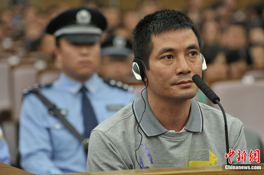 Naw Kham and five other suspects, charged with the murders of 13 Chinese sailors, appear in court in Kunming, Yunnan Province, on Thursday.