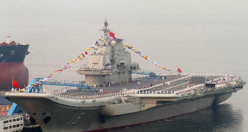 China's first aircraft carrier held a flag-raising ceremony yesterday, amid rising tensions over the Diaoyu Islands in the East China Sea.