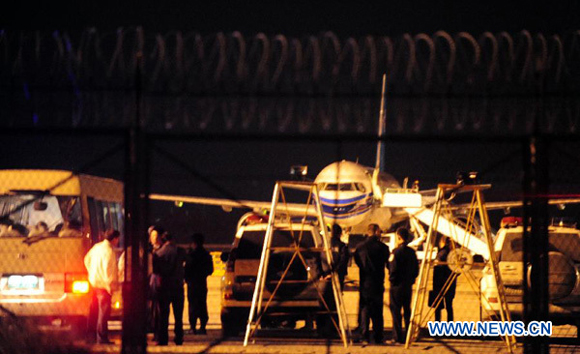 Officials with the local public security department handle a passenger plane forced landing incident at Gansu Zhongchuan Airport in Lanzhou, Gansu Province, Oct. 8, 2012.