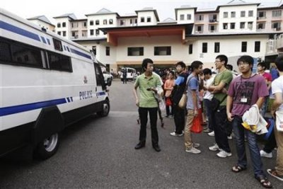 Link to Chinese drivers face charges over Singapore strike
