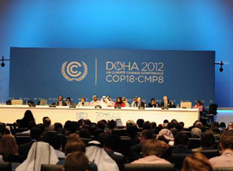 Doha climate talks reach weak commitment