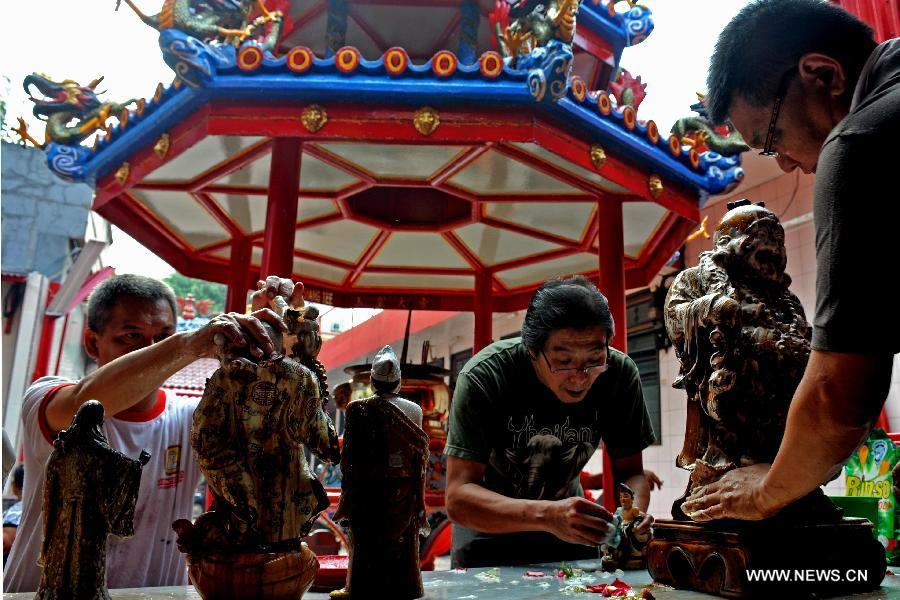 Buddha cleaned in Indonesia for the Chinese Lunar New Year