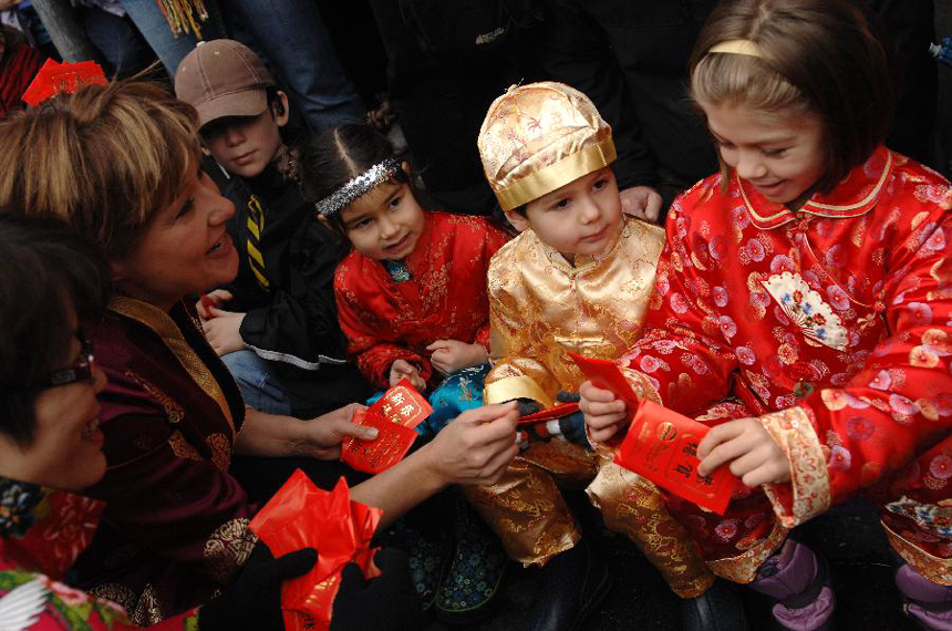 Premier of British Columbia Christy Clark (2nd L) interacts with kids during a Lunar New Year of the Snake celebration at Chinatown in Vancouver, Canada, Feb. 17, 2013. The grand parade is one of the largest in North America, drawing 70,000 people to the streets of Chinatown.