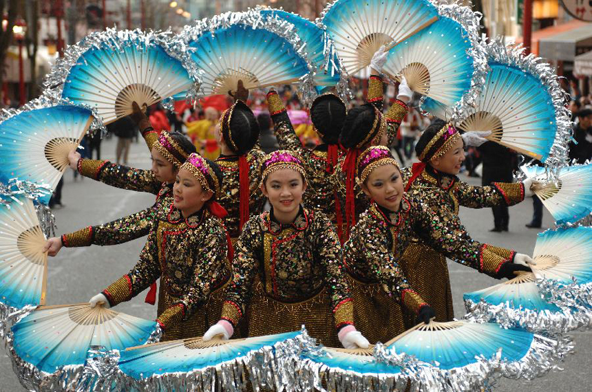 Girls perform during a Lunar New Year of the Snake celebration at Chinatown in Vancouver, Canada, Feb. 17, 2013. The grand parade is one of the largest in North America, drawing 70,000 people to the streets of Chinatown.
