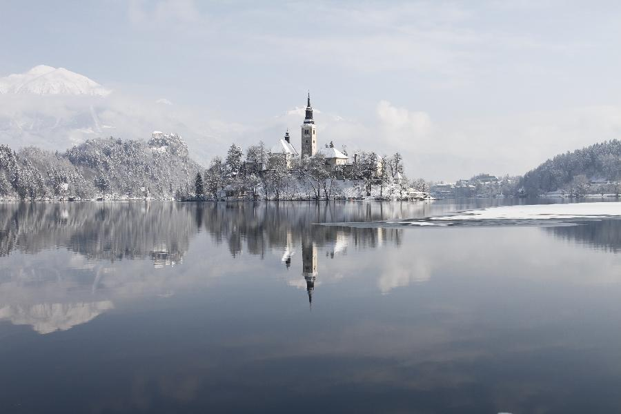 Heavy Snowfall Shrouds Beautiful Lake Bled In Nw Slovenia