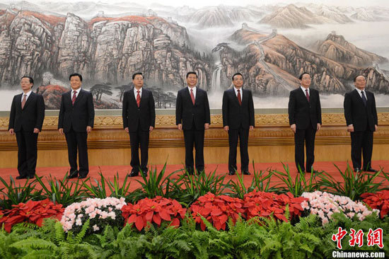General Secretary of the Central Committee of the Communist Party of China (CPC) Xi Jinping (C) and the other newly-elected members of the Standing Committee of the 18th CPC Central Committee Political Bureau Li Keqiang (3rd R), Zhang Dejiang (3rd L), Yu Zhengsheng (2nd R), Liu Yunshan (2nd L), Wang Qishan (1st R), Zhang Gaoli (1st L) meet with journalists at the Great Hall of the People in Beijing, capital of China, Nov. 15, 2012. [Photo/China News Service]