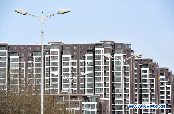 The municipal governments of Chinese capital Beijing and business hub Shanghai on Saturday spelled out detailed rules aimed at cooling the property market following the central government's fresh regulatory plan earlier this month. [File photo]