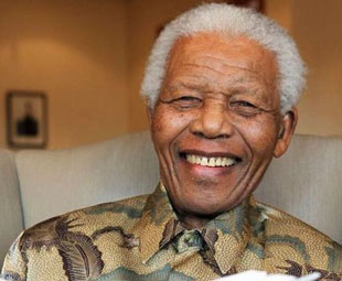 Mandela continues to receive treatment in hospital