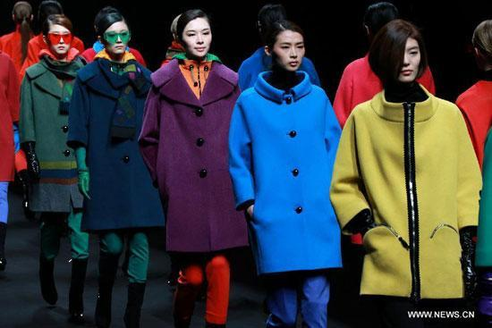 Models present creations at the Korean Designers' Collection show during the China Fashion Week (A/W 2013/2014) in Beijing, capital of China, March 29, 2013.