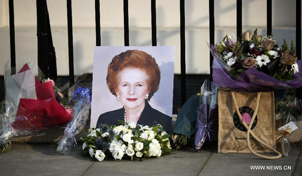 Flowers are laid outside the residence of Baroness Thatcher at the Chester Square in London, Britain, on April 8, 2013. [Xinhua]