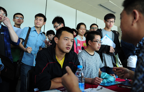 Students attend a job fair held in Xi'an, Shaanxi Province, on May 29, 2013.